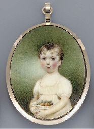 A young girl holding fruit in