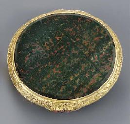 A gold-mounted garnet-set bloo