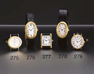 Cartier. An 18K gold oval-shap