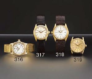 Rolex. A rare 18K gold left-ha