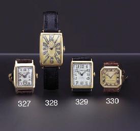 Rolex. A 9K gold tonneau-shape