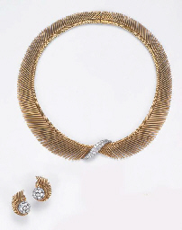 A DIAMOND-SET NECKLACE AND EAR
