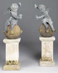A pair of cast lead cherubs on