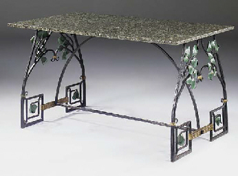 A polychrome wrought iron tabl