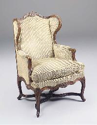 A Louis XV walnut bergere avec
