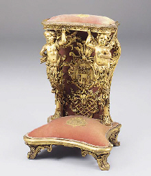A carved giltwood and decorate