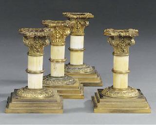 A set of four gilt brass and i