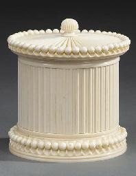 An ornamentally turned ivory c