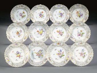 Twelve Meissen pierced plates