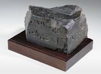 AN EGYPTIAN GRANITE FRAGMENT