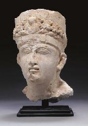 A PALMYRENE LIMESTONE HEAD OF