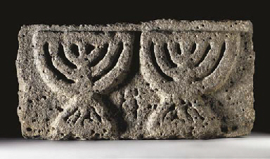AN EARLY JEWISH BASALT MENORAH
