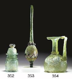 A LATE ROMAN GLASS BOTTLE