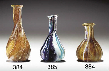 A ROMAN MARBLED GLASS UNGUENTA