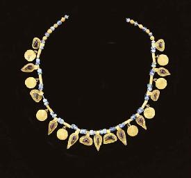 A GREEK GOLD, GARNET AND GLASS