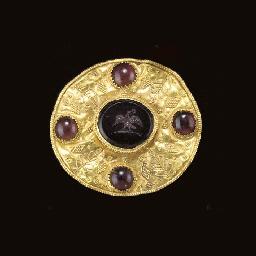 A ROMAN GOLD AND GARNET DISK