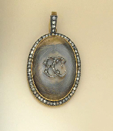 AN EDWARDIAN LOCKET PENDANT