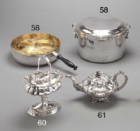A silver covered casserole and