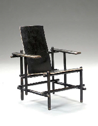 'BILLET CHAIR', AN EBONIZED AN