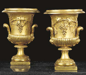 A PAIR OF CARVED GILTWOOD URNS