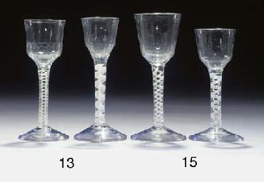Two opaque-twist wine-glasses