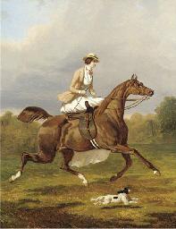 A lady riding side saddle