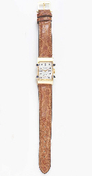 A SAPPHIRE AND GOLD WRISTWATCH