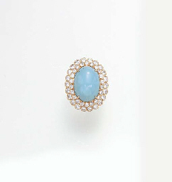 A TURQUOISE AND DIAMOND RING,