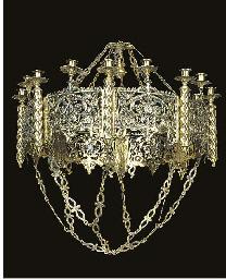 A brass ecclesiastical sixteen
