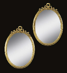 A pair of oval giltwood and co