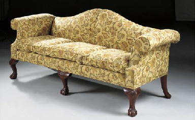 A MAHOGANY AND UPHOLSTERED SOF