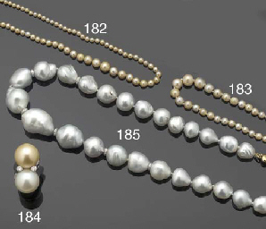 A GRADUATED PEARL NECKLACE AND