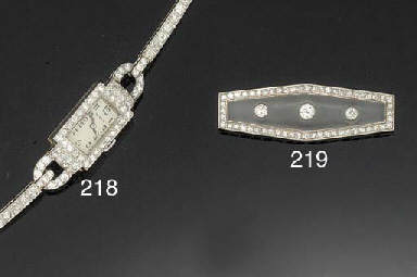 A LADY'S 18CT. WHITE GOLD AND