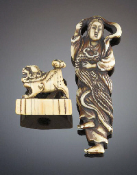 A stained ivory netsuke of a g