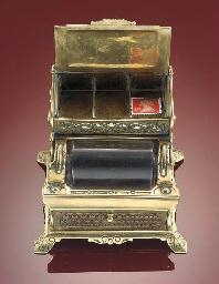 A brass combination three-divi