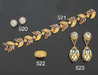 Bracciale in oro, rubini e bri