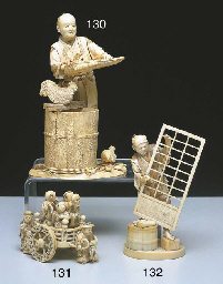 * A JAPANESE IVORY FIGURE OF A