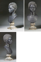 A CARVED BLACK MARBLE BUST OF