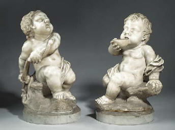 A PAIR OF CARVED MARBLE PUTTI
