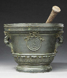 A BRONZE MORTAR WITH IRON PEST