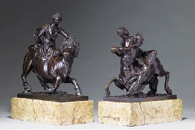 A PAIR OF BRONZE GROUPS DEPICT