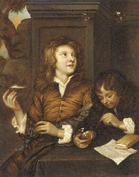 Two boys blowing bubbles from