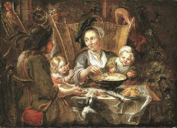 A peasant family dining in an