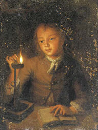 A boy reading by candlelight