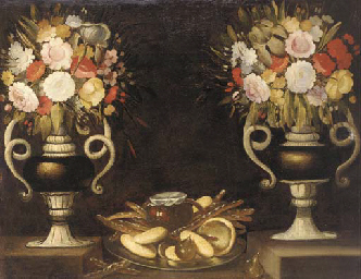 Mixed flowers in a pair of urn