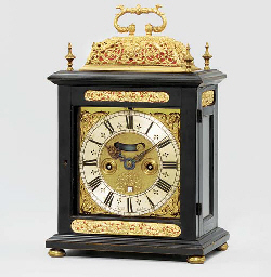 a queen anne ebonised striking table clock