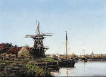 A Barge moored by a windmill b
