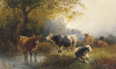 Cows grazing on a river bank