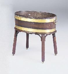 A mahogany and brass bound ova