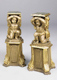 A pair of giltwood pedestals,